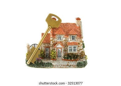 The house with key isolated over white background