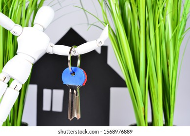 House key with a house as a keyring to the new home.