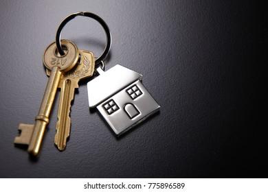 house key on the black background