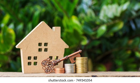 House and Key on stack of coins.