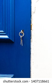 House Key and Key ring in Blue door of new home for mortgage,real estate, concept for real estate, moving home or renting property , investment, home security, concept