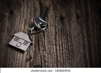 House key ring and old wood background. Close up