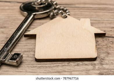 House key with wooden house key chain