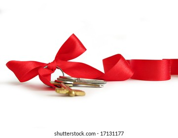 House keys decorated by red ribbon