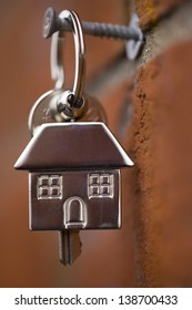 house keys hanging by a brick wall
