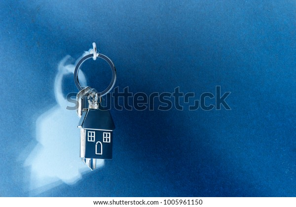 house keys hanging by a wooden wall