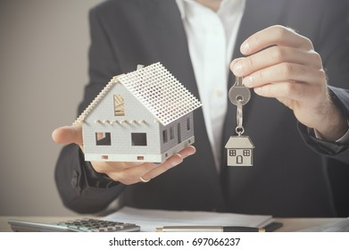 House keys and model house concept for selling or moving home