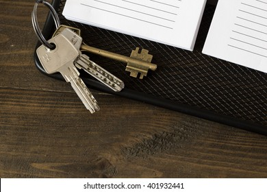 house keys on the notebook top view