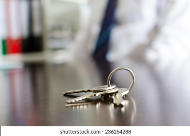 House keys on a wooden table