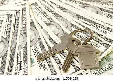 House keys over the hundred dollar banknotes