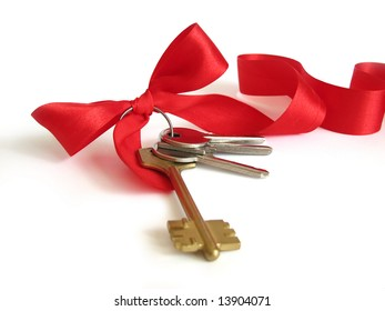 House keys with red bow from ribbon