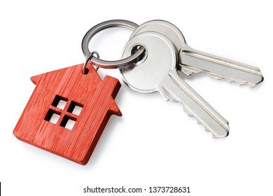 House keys with a red house shaped keychain, isolated on white background