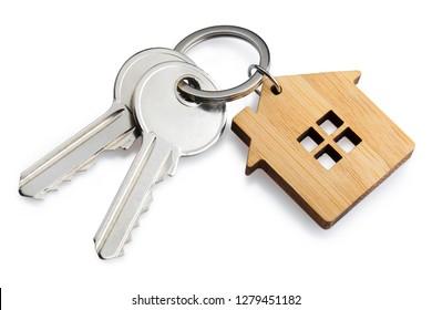 House keys with house shaped keychain, isolated on white background