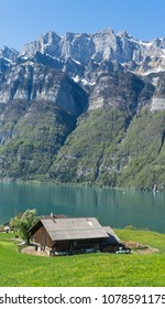 House at the lake and the mountain at the background in Switzerland