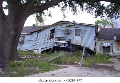 House landing on overturned truck - Hurricane Katrina