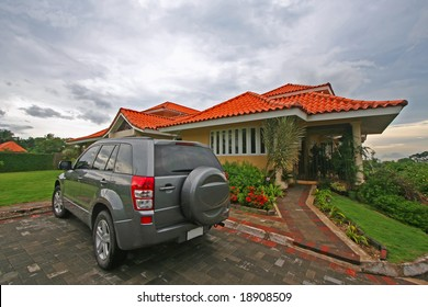 house lawn and vehicle