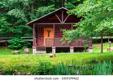 House of the log. House of extruded wooden profile in the forest.
