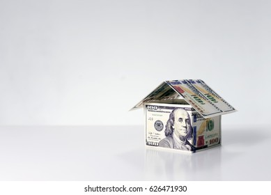 House made from 100 Dollars banknotes on a white background.