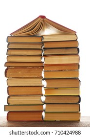 House made of books isolated on white background
