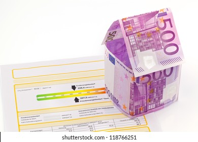 a house made of euro money appear and an energy certificate. building society, building houses and buying a house.