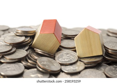 the house made from wooden toy blocks on coin background