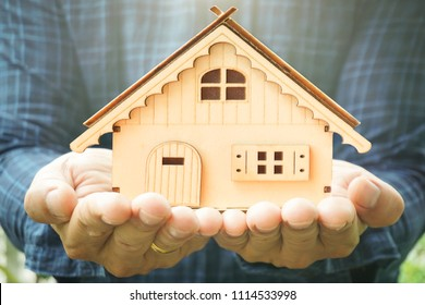 House in man hand show savings money and savings to buy a home or buy real estate. Or show a home loan or divide the investment for retirement. Or for the future Concept of money.