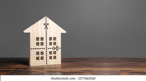 House with marked lines for cutting into four equal parts. Distribution of the right. Divorce concept. Disputes over division process of real estate and property after divorce. Legal service