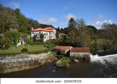 house, mill and waterfall