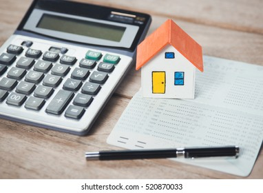House model and Bank account ,calculator on table for finance ,banking concept.