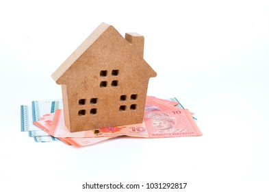 House model and banknotes isolated on white background. Real estate concept.