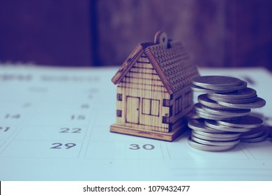 house model with calendar ,last day of month,concept for pay,rent,buy or real estate.