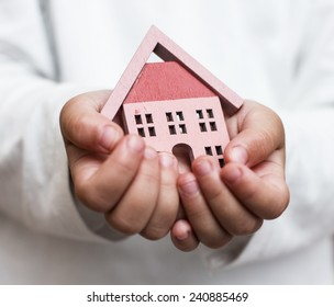 House model in the child hand.Investment for the Future.