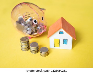 House model and coin money on yellow background,save money concept,Minimal creative style.