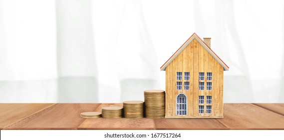 House Model and coins . Housing and Real Estate concept. home business idea