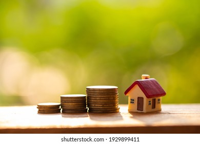 House Model and Golden Coins Stacks with blur Background, Business, Finance and Banking concept.