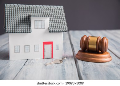 house model with judge gavel on the table