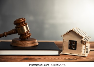 house model with judge on book on table