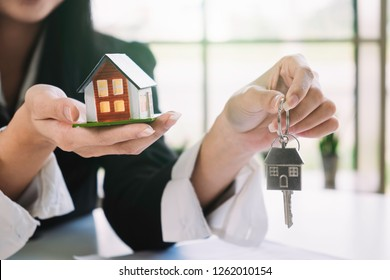 House model and key on table for finance and banking concept.Home purchase mortgage concept.