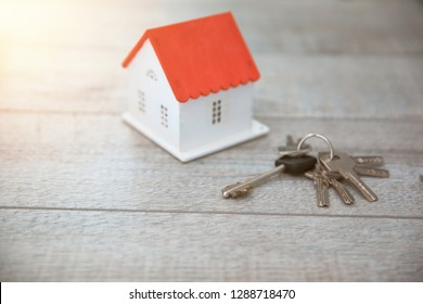 house model with key on table