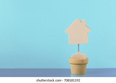 House model minature on blue background. Real estate, rent, sale or buying property concept. Copy space for text