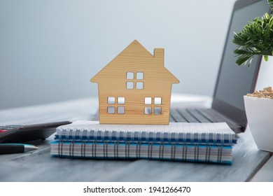 house model with notepad on comuter on the table