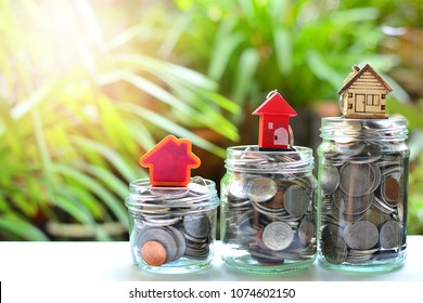 house model on coins saving for concept investment fund finance and mortgage home  loan