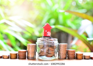 house model on coins saving for concept investment mortgage fund finance and home loan