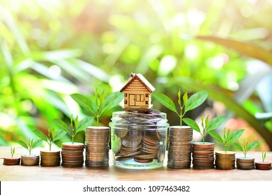 house model on coins saving for concept investment mortgage fund finance and interest rate home loan