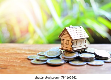 house model on coins saving for concept investment mortgage finance and home loan