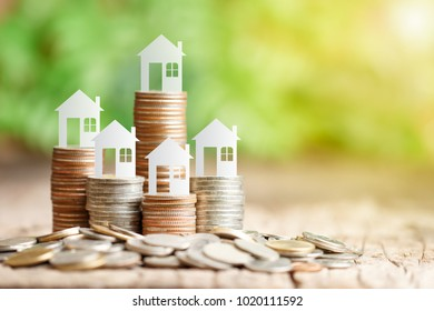 House model on coins stack for saving to buy a house