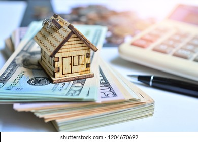 house model on money cash saving for concept investment mortgage fund finance and home loan