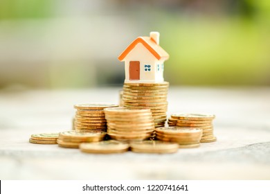 House model on stack of coins.