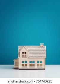 House model over blue background