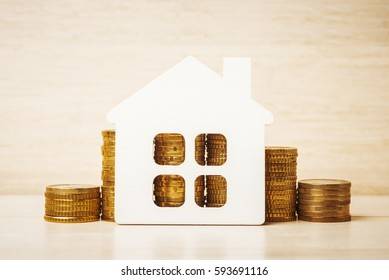 House model over Euro coins, mortgage and credit concept